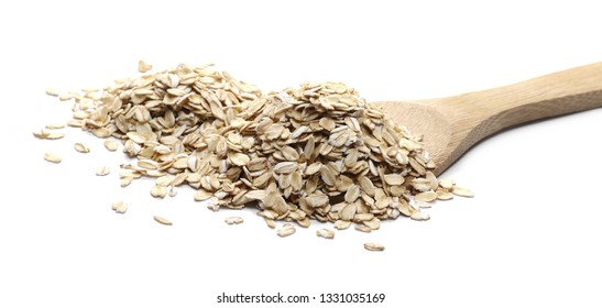 Oats, rye grain cereal for breakfast with wooden spoon isolated on white background