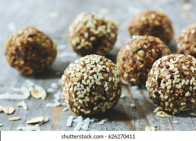Oatsmeal sesame protein balls / Low fat energy bites with oatmeal nuts sesame, selective focus