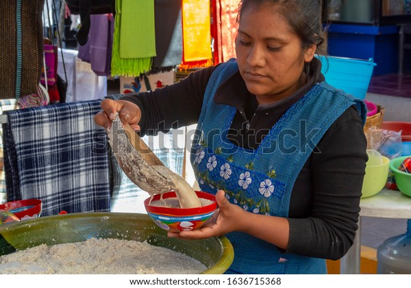 Oaxaca de Juárez, Oaxaca de Juárez/mexico- 2018 December 30th: A local woman serving Tejate, traditional drink based on cacao and corn for god at Tlacolula market,