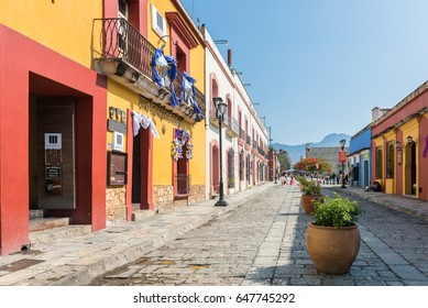 Oaxaca, Mexico - April 17, 2017: Colorful buildings on the cobblestone streets of Oaxaca, Mexico