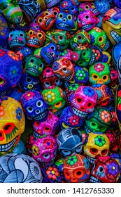 OAXACA, MEXICO - JANUARY 5, 2019 Colorful Mexican Ceramic Skulls Handicrafts Day of the Dead Oaxaca Juarez Mexico.