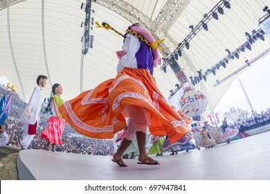 Oaxaca, Mexico - July 24, 2017: Calenda (Giant dancer with costume) from the region Chinas Oaxaqueñas in Guelaguetza festival.