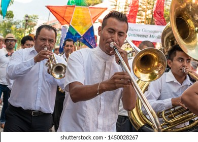 OAXACA, OAXACA, MEXICO- JULY 6, 2018: Traditional musical band during the Convite, a party made for invite to a big traditional party called Guelaguetza in Oaxaca, Mexico