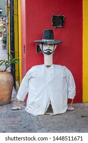 OAXACA, OAXACA, MEXICO- JULY 6, 2019: Giant puppet called marmota, made of reed and cardboard, during the Convite, a party made for invite to a big traditional party called Guelaguetza in Oaxaca, Mexi
