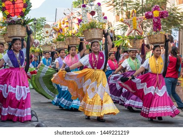 OAXACA, OAXACA, MEXICO- JULY 6, 2019: Girls dressed with traditional clothes during the Convite, a party made for invite to a big traditional party called Guelaguetza in Oaxaca, Mexico