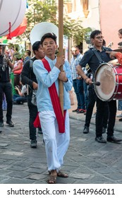 OAXACA, OAXACA, MEXICO- JULY 6, 2019: Young man dressed with traditional clothes during the Convite, a party made for invite to a big traditional party called Guelaguetza in Oaxaca, Mexico