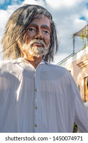 OAXACA, OAXACA, MEXICO- JULY 6, 2019: Giant puppet dressed as the painter Francisco Toledo during the Convite, a party made for invite to a big traditional party called Guelaguetza in Oaxaca, Mexico
