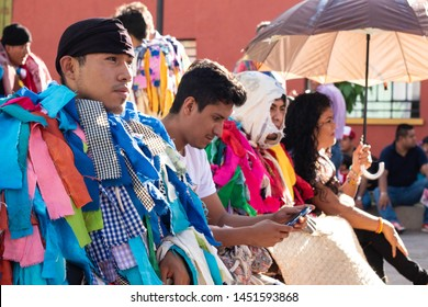 OAXACA, OAXACA, MEXICO- JULY 6, 2019: Young man dressed as tiliche, traditional costume from Putla, Oaxaca, during the Convite, a party made for invite to a big traditional party called Guelaguetza in