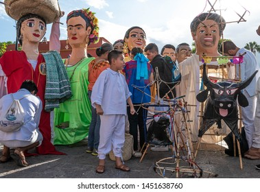 OAXACA, OAXACA, MEXICO- JULY 6, 2019: Boy with toritos, structures with fireworks and giant puppets during the Convite, a party made for invite to a big traditional party called Guelaguetza in Oaxaca,