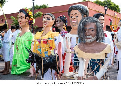 OAXACA, OAXACA, MEXICO- JULY 6, 2019: Giant puppets dressed as famous painters during the Convite, a party made for invite to a big traditional party called Guelaguetza in Oaxaca, Mexico