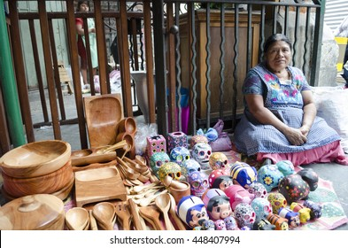OAXACA MEXICO- MARCH 21, 2016: Woman posing with typical handicraft in a market in Oaxaca, Mexico