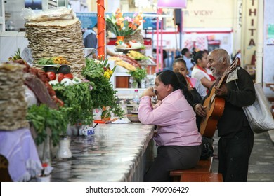 OAXACA, MEXICO - MARCH 6th, 2012: People on a central Oaxaca market eating on a market food court in Oaxaca, Mexico