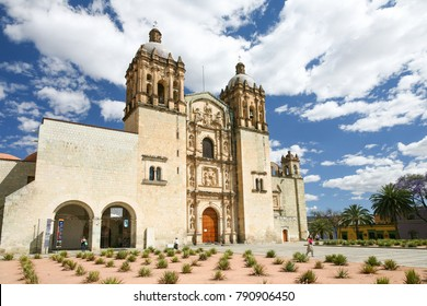 OAXACA, MEXICO - MARCH 7th, 2012: People walk by the Church of Santo Domingo de Guzman in Oaxaca, Mexico