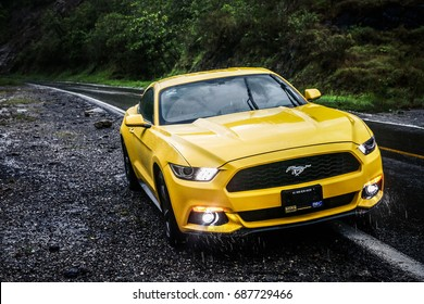 OAXACA, MEXICO - MAY 24, 2017: Yellow sportcar Ford Mustang at the interurban road.