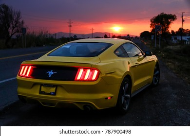 Oaxaca, Mexico - May 26, 2017: Yellow muscle car Ford Mustang at the interurban road.