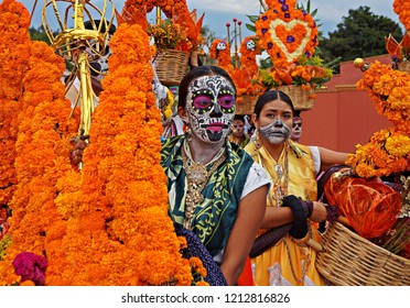 OAXACA , MEXICO - NOVEMBER 01, 2014: Unknown participants on a carnival of the Day of the Dead in Oaxaca, Mexico. The Day of the Dead is one of the most popular holidays in Mexico