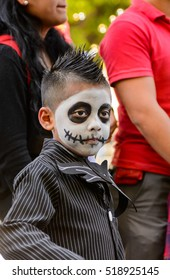OAXACA, MEXICO - OCT 31, 2016: Unidentified boy painted as zombie for the Day of the Dead (Dia de los Muertos), national Mexican holiday, UNESCO Intangible Cultural Heritage of Humanity