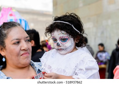 OAXACA, MEXICO - OCT 31, 2016: Unidentified girl painted as zombie for the Day of the Dead (Dia de los Muertos), national Mexican holiday, UNESCO Intangible Cultural Heritage of Humanity