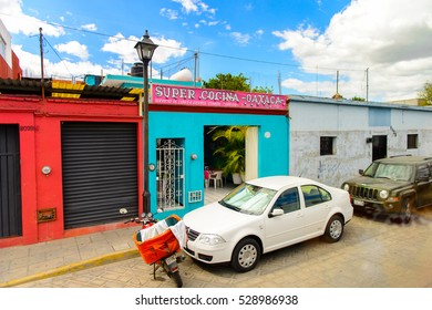 OAXACA, MEXICO - OCT 31, 2016: Small colored houses on the typical street of Oaxaca de Juarez, Mexico. The name of the town is derived from the Nahuatl name Huaxyacac