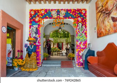 OAXACA, OAXACA, MEXICO- OCTOBER 30, 2017: Colorful decoration with skulls and flowers for mexican Day of the Dead celebration at a commercial zone in Oaxaca, Mexico