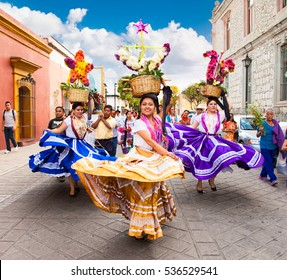 OAXACA, MEXICO-DEC 10, 2015: Beautiful ladys celebrating Day of the Virgin of Guadalupe (Dia de la Virgen de Guadalupe) on Dec 10, 2015 . Oaxaca, Mexico. It is a popular Catholic feastival
