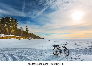 Ob, Novosibirsk region, Western Siberia, Russia - March 10, 2018: winter Bicycle on the ice of the Ob sea