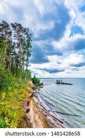 "Ob reservoir, Berdsk, Novosibirsk region, Western Siberia, Russia - August 10, 2019: city recreation Park and beach ""On the rocks"""