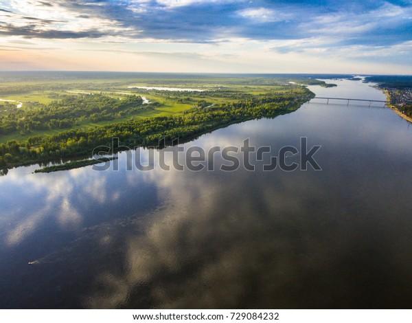 Ob river landscape. Ships sailing down the river. Siberia, Russia