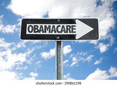 Obamacare direction sign with sky background