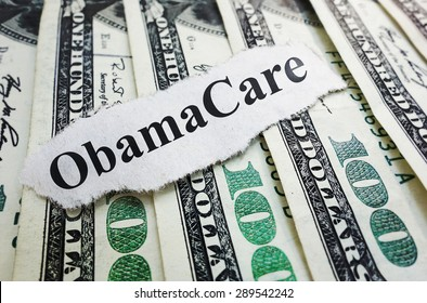 Obamacare newspaper headline on cash - Affordable Care Act cost concept