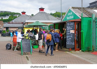 OBAN, SCOTLAND -15 JUL 2017- The landmark Oban Seafood Hut (Green Shack) next to the CalMac ferry terminal in the harbor town of Oban, in Argyll and Bute, known as the seafood capital of Scotland.