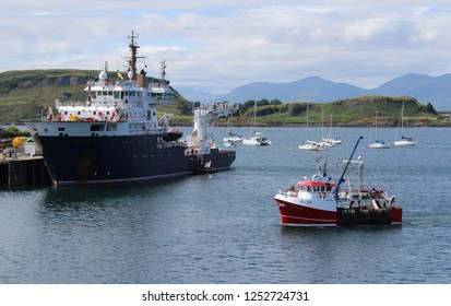 OBAN, SCOTLAND, 25 JULY 2018: View accross Oban Harbour towards the Isle of Mull. Oban is a town in the Western Highlands and the 'Gateway to the Isles'.