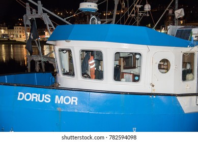 Oban, Scotland - August 14 2017: night at the port with moored merchant ships of the city of Oban in Scotland England