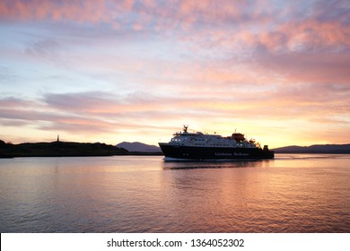 OBAN, SCOTLAND - MAY 03, 2017: A Caledonian MacBrayne (CalMac) ferry entering Oban harbor in the sunset