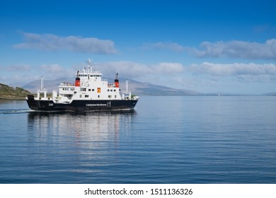Oban, Scotland - May 15th 2018 - Ferry leaving Oban to go to remote scottish hebrides island on calm summer day, taking tourists and local people