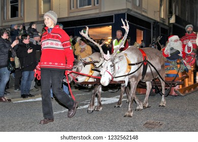 OBAN, SCOTLAND, UK : 17 November 2018 : Father Christmas on his sleigh pulled by reindeers during the parade for switching the Christmas Lights on at the Oban Winter Festival