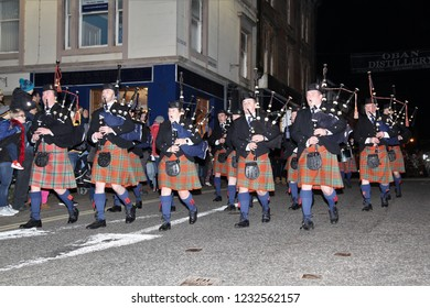 OBAN, SCOTLAND, UK : 17 November 2018 : Marching Scottish Pipe Band lead the Parade during the switching on of the Christmas Lights at the Oban Winter Festival