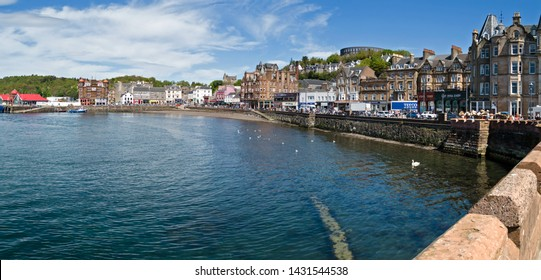 Oban, Scotland, UK - May 6th 2017: Panoramic image of Oban town, harbour and quay, Argyll and Bute, Scotland, UK. Editorial image.