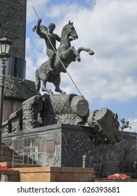 Obelisk with a statue of Nike and a monument of St George slaying the dragon in the Victory Park, Moscow, Russia.