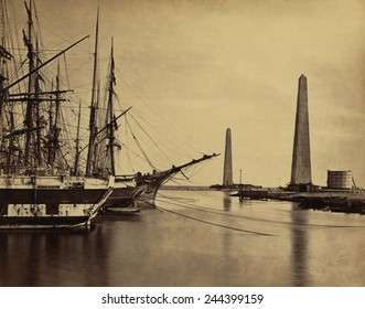 Obelisks on shore and ships moored at the Port Said entrance to the Suez Canal. 1860 photo by Francis Frith.