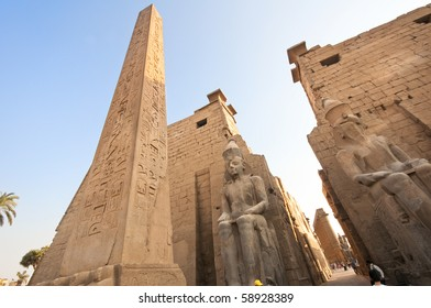 Obelix and statues of Ramses  II at the first pylon of the Luxor Temple (1279-1213 BC)