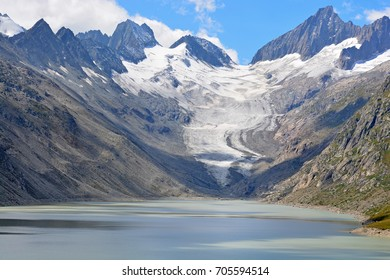 Oberaarhorn (r) and Oberaarrothorn (l) either side of the Oberaar glacier and the Oberaar lake in the Bernese Alps Switzerland