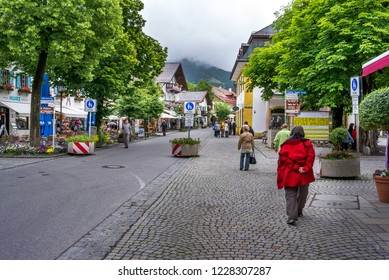 Oberammergau, Germany - June 01, 2011: Main Street in Oberammergau a town in the Bavarian Alps known for its once a decade performance of the Passion Play in the Passion Play Theater.