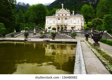 OBERAMMERGAU, GERMANY - JUNE 10: Linderhof Palace and garden on June 10, 2012 in Oberammergau, Germany.  Linderhof Palace is the smallest of the three palaces built by King Ludwig II of Bavaria;