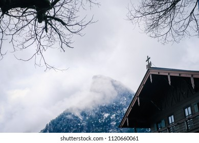 Oberammergau, Germany - March 30, 2018 : Beautiful view of old town city and building paintings with the mountain background in Oberammergau, Germany, Europe
