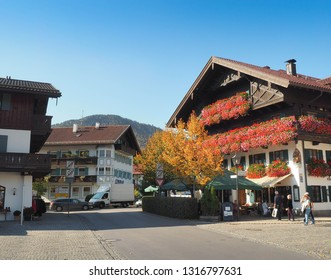 OBERAMMERGAU, GERMANY - OCTOBER 15: A traditional Bavarian building decorated by flowers in old town of Oberammergau, Germany on October 15, 2018