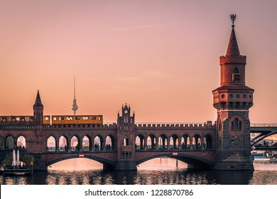 Oberbaum Bridge in Berlin at Sunset with View on the  Television Tower