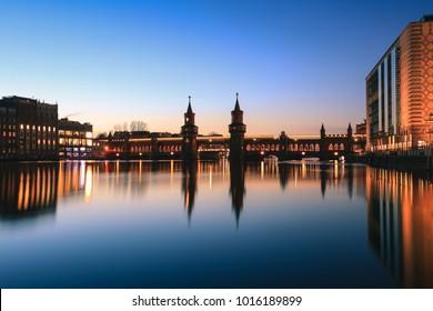 Oberbaum bridge over spree river at twilight in Berlin, Germany