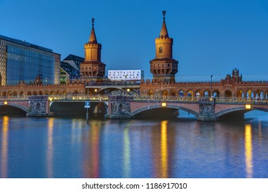 The Oberbaumbridge and the river Spree in Berlin at night, Germany