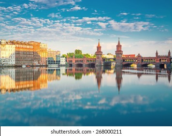 Oberbaumbruecke Berlin Summer with Reflection and Clouds